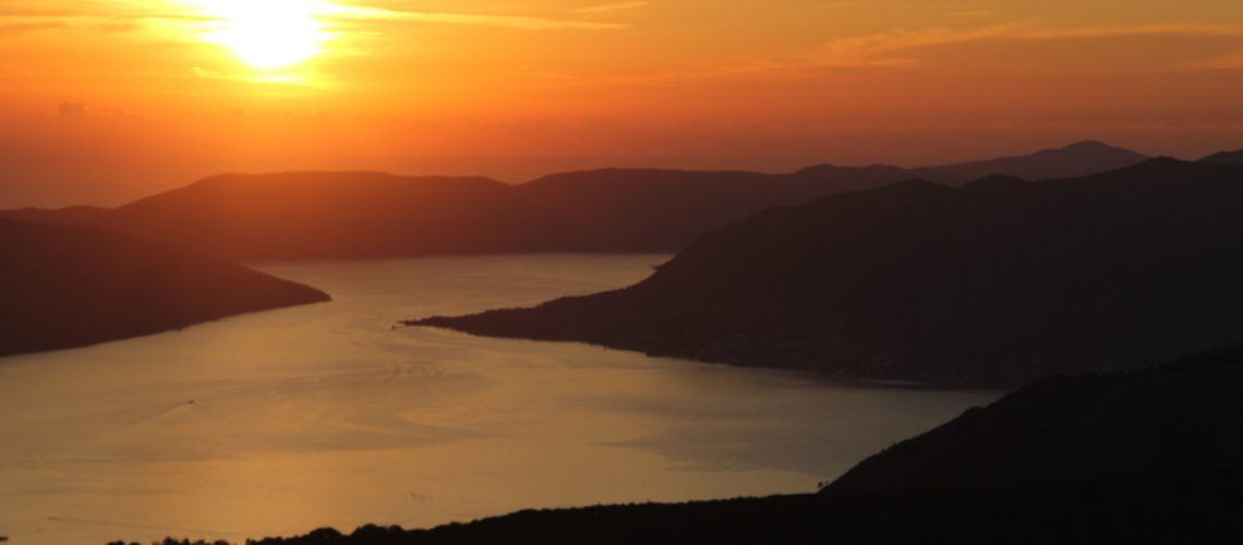 The sunset cascades over the Bay of Kotor turning the Adriatic into a golden sea